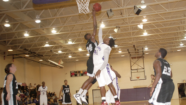 Northside's Edrice Adebayo (24) blocks a shot during a game last season. As a freshman, Adebayo averaged 17 points and 19 rebounds for the Panthers last year.