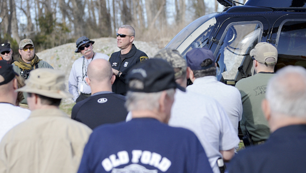 PILOT BRIEFING: North Carolina State Highway Patrol helicopter pilot Martin Horne Jr. teaches search and rescue volunteers about how he and his copilot go about doing searches from the air. Later, Horne would instruct volunteers from the air as to the location of a victim on the ground below.