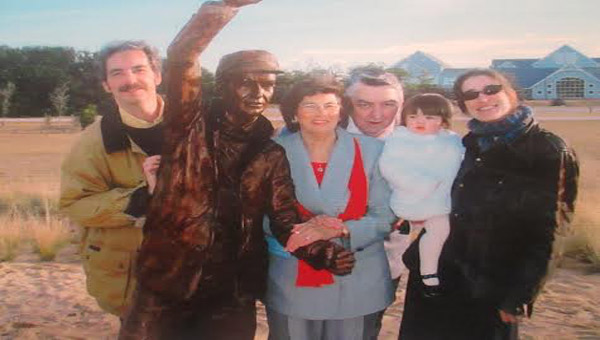 This photo was taken on Dec 16,2005 and left to right is  of Lee, Karen, and Milton Brickhouse , Chloe Davis, and Lisa Brickhouse Davis. All are descendants of Johnny Moore.