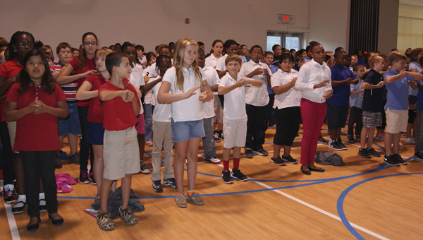 JOHN SMALL ELEMENTARY | CONTRIBUTED RED, WHITE AND BLUE: John Small Elementary held its Constitution Day on Sept. 17, celebrating the constitution and the meaning of the American flag and the freedom it represents. Fifth-grade students, donning red, white and blue shirts, gave a performance, which featured them reciting the Preamble and using sign language to represent its words.