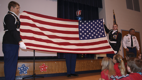 JOHN SMALL ELEMENTARY | CONTRIBUTED COLORS: Washington High School JROTC was in attendance during John Small Elementary's Constitution Day, at which it presented an American flag and how to properly fold it.