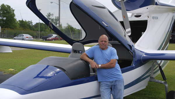 FILE PHOTO| DAILY NEWS WRIGHT FLIGHT SUPPORTER: Tom Saccio flew many Wright Flight participants in his Seawind. Saccio died Thursday in a plane crash in Indiana.