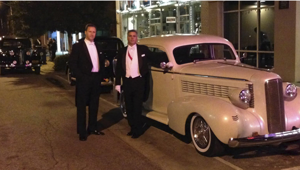 """BEAUFORT COUNTY ARTS COUNCIL   CONTRIBUTED AND…SCENE: (Left) Actor Steve Kwiatkowski, who plays """"Andrew"""" in """"Holey Matrimony!"""" and Jeff Winkler, as James, the millionaire, wait outside the Turnage Theater to film a scene. Parts of the movie were filmed at the Washington Theater in March, and the film will premiere at the theater at 8 p.m. tonight."""