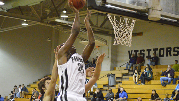 DAVID CUCCHIARA | DAILY NEWS ON THE BOARDS: Junior Edrice Adebayo elevates for a layup in the third quarter of Wednesday's win over First Flight. He finished with 41 points and 19 rebounds.