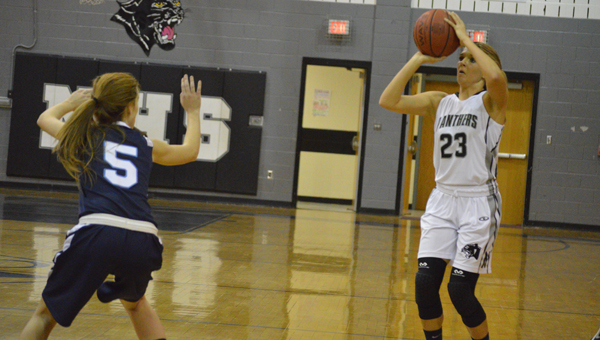 DAVID CUCCHIARA   DAILY NEWS NEW ROLE: Senior guard Alex Adams fires a shot from range in the first quarter of Wednesday's game against First Flight. Adams finished with 23 points.