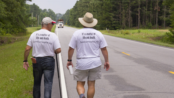 ERIC BYLER QUEST FOR HEALTHCARE: Civil rights advocate Bob Zellner walks with Belhaven Mayor Adam O'Neal on N.C. Highway 45 North near Merry Hill during last year's walk to D.C. O'Neal and representatives from 14 states will begin a second, 14-day walk to D.C. on Monday.