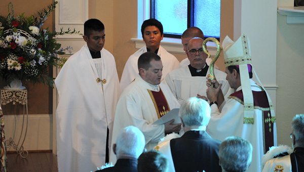 MOTHER OF MERCY CATHOLIC CHURCH INSTALLATION: Mother of Mercy Catholic Church celebrated the installation of Father Brendan Buckler, former administrator of the church, as priest of the parish Monday night. Pictured, Buckler renews his promises he took at ordination in obedience to the bishop of the Diocese of Raleigh and the teachings of the Catholic Church and Christ passed down from the apostles.