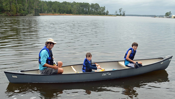 SETH EFFRON FACING THE ELEMENTS: Scott Huler's (pictured left) recent completion of Lawson's Trek culminated from a canoe trip with sons Gus, 7, (pictured middle) and Louie, 10, (pictured right). The Hulers completed the last leg of the journey facing wind and drizzling rain, making it difficult for them to canoe up the Pamlico River.