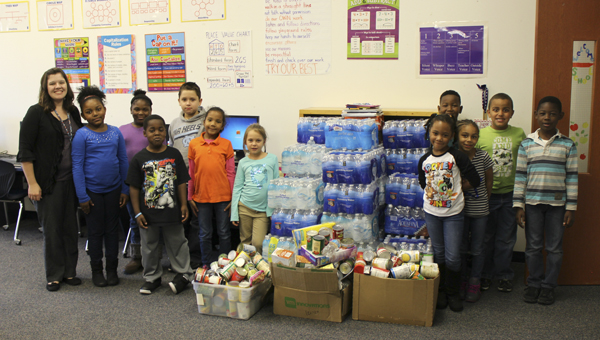 SARAH HODGES | CONTRIBUTED Students from S.W. Snowden show some of the items they have collected to help flood victims in South Carolina.