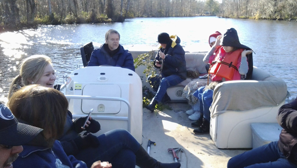 NC ESTUARIUM KNOWLEDGE IS POWER: The North Carolina Estuarium offers an educational experience to keep students learning over Christmas break and all year long. In early December, the Estuarium hosted Mistletoe River Roving tours to teach all ages of participants about the holiday plant.