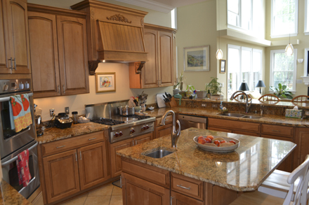 DAYS OF YORE: It used to be that cooks disappeared into the kitchen, away from guests. Open-concept kitchens like this allow the chef to be a part of the party while cooking up dinner.