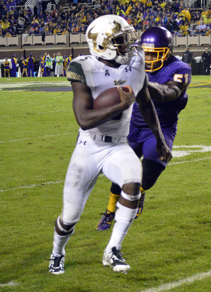 USF running back Marlon Mack runs along the sideline in last season's meeting. Mack, one of the conference's elite running backs, may prove to be a big problem for ECU's defense.