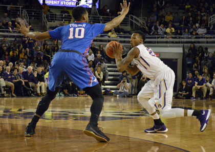 B.J. Tyson uses a ball fake to fool SMU's Jarrey Foster. Tyson will play some point guard this year, but coach Jeff Lebo and the Pirates will also rely on some freshman talent, too.